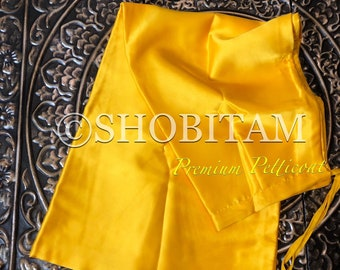 Premium Quality bright yellow Satin Petticoat for saree,  in standard size.