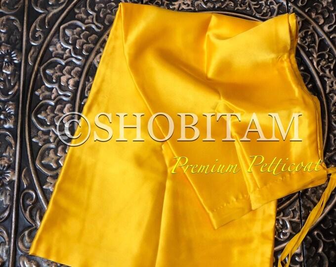 Premium Quality bright yellow Satin Petticoat for saree,  in standard size.