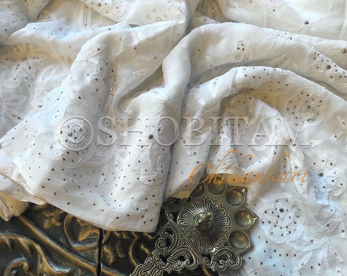 Mukaish work and hand Chikankari work on white georgette Saree! White Chikankari Saree   Shobitam Saree