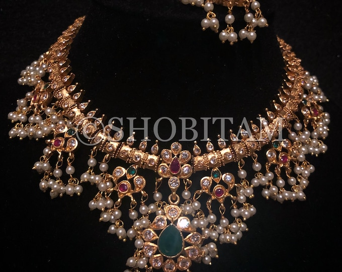 Kala Necklace Set  -  Studded necklace and Earrings set with faux stones in bright gold  finish  | Shobitam Jewelry