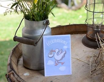 Congratulatory card birth blue stork