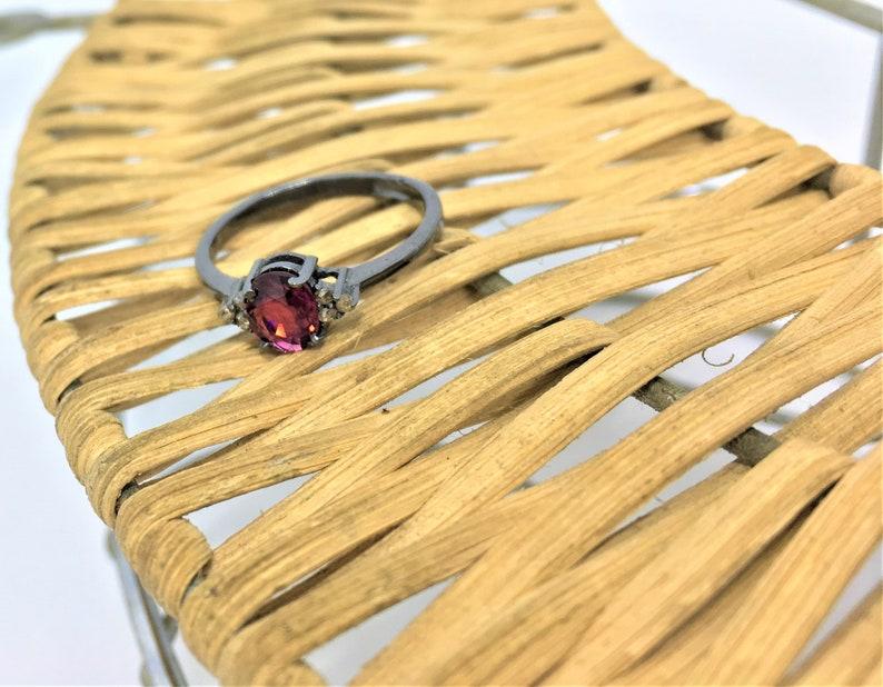 Rhodolite garnet and diamond ring in sterling silver.