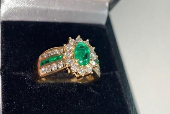 Amoro diamond and emerald ring