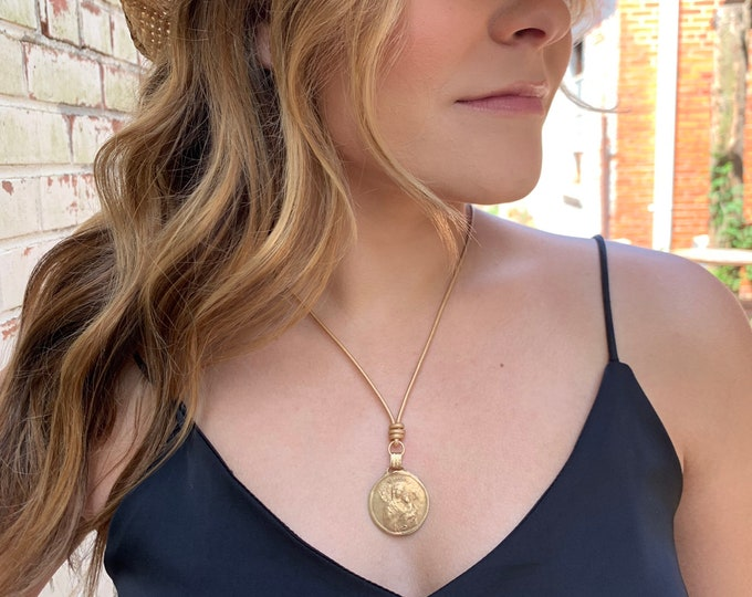 Drop Pendant on Metallic Leather   Matte Gold Necklace   Mary and Baby Jesus   Bronze   Our Lady of Perpetual Help