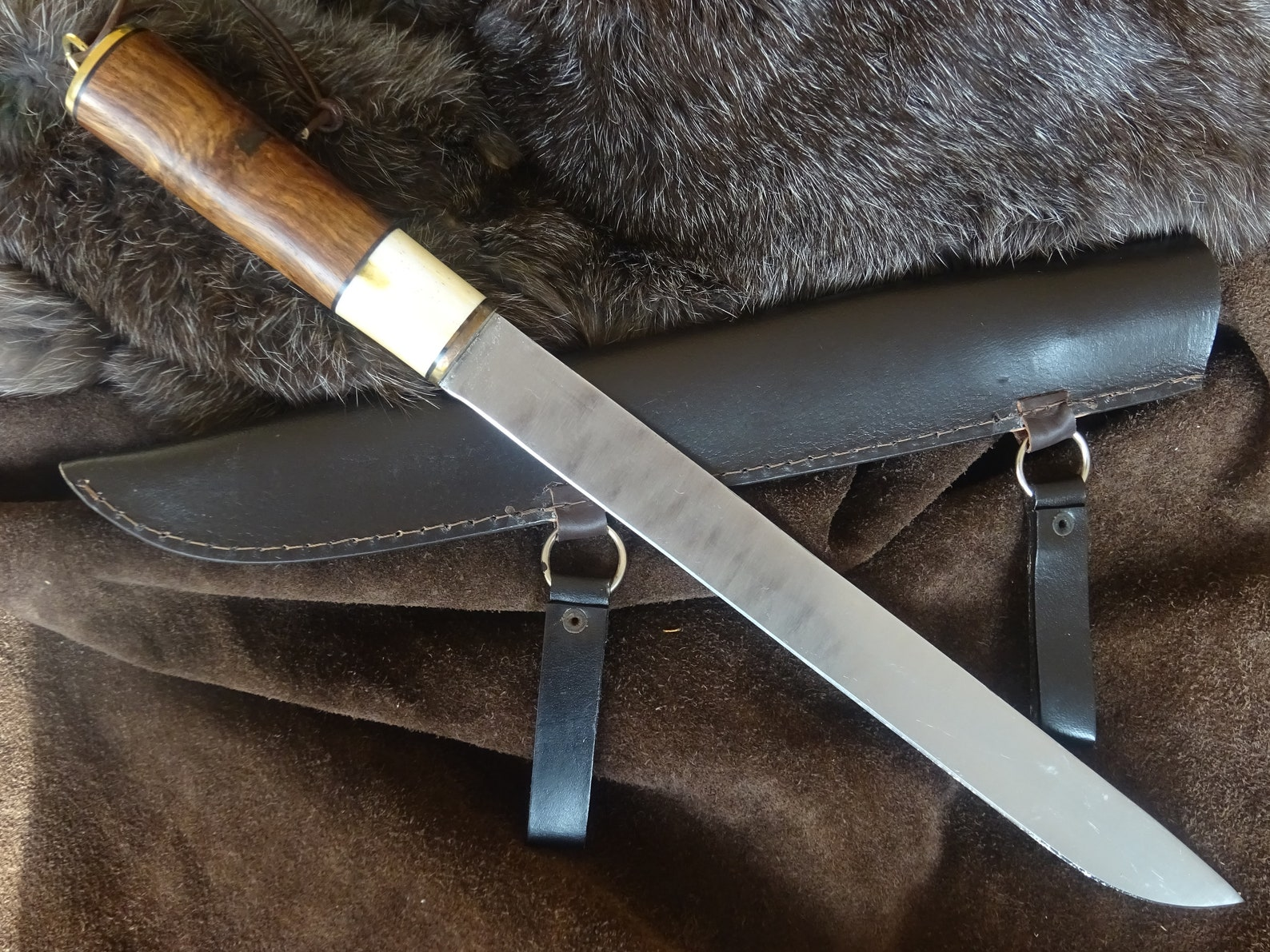 Large sax knife with sharp blade and handle made of wood