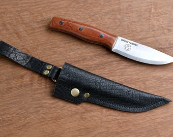 slicer by infinity knives is a bushcraft / survival knife -made with o1 high carbon steel and has a full tang comes with a leather sheath