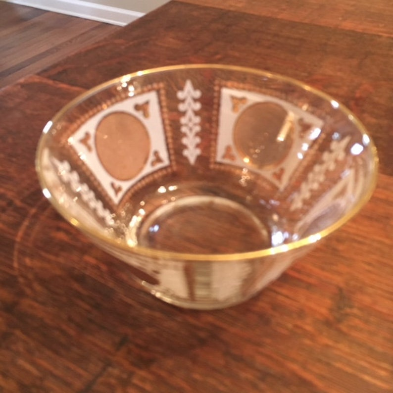 Gold and white painted small dish 5 round