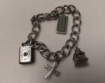 Vintage Monet Bracelet with Silver Christian Charms Including Two Stanhope Viewers
