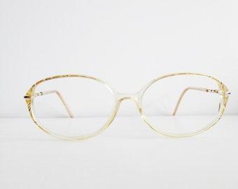70042e423a 1990 vintage oval golden women eyeglasses frames - DEADSTOCK