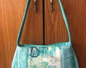 Quilted panel shoulder bag