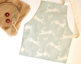 Montessori apron 5-6 years, Hopping Hare on Blue, child sized apron