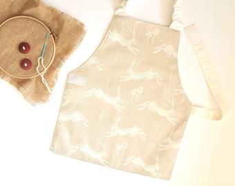 Montessori apron 5-6 years, Hopping Hare on Cream, child sized apron