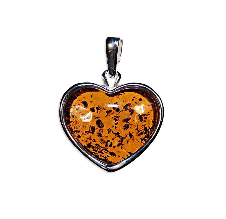 Amber pendant and silver heart