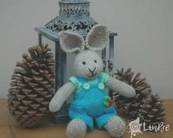 Knitted Rabbit in turquoise dungarees