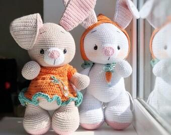 Handmade crochet rabbit toys on green background. Amigurumi doll ... | 270x340