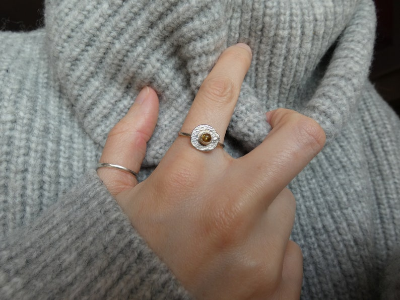 Silver ring set with amber