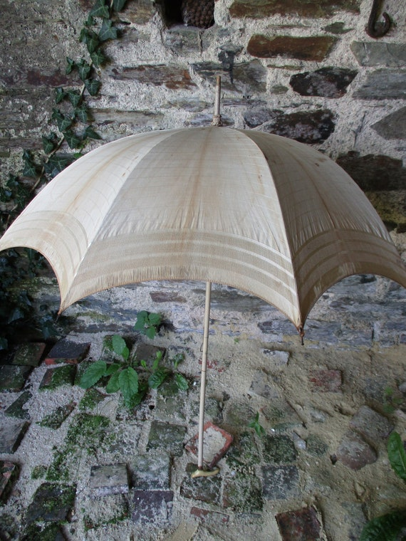 Antique parasol. Vintage parasol. Re-enactment. Co