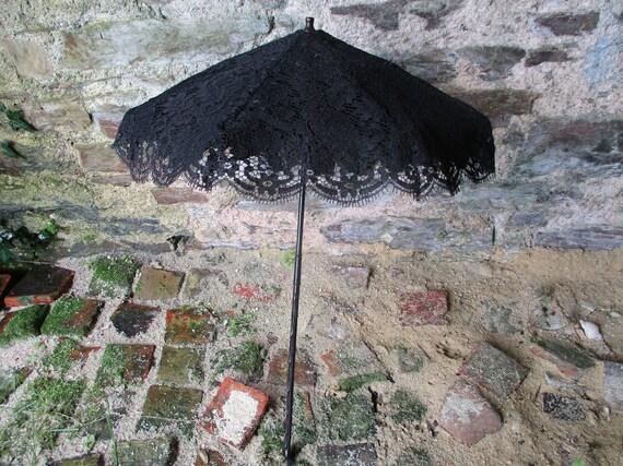 Antique parasol. Black parasol. French antique par
