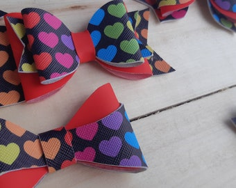 Black rings with multicolored hearts Ready to go
