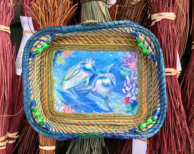 200 - The Explorers - a pair of dolphins basing blue and green accented basket