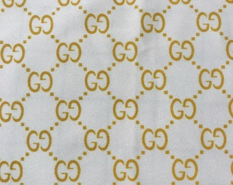 224821dbb779 GG Designer inspired stretch fabric, white with gold color monogram