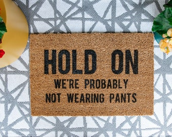 HOLD ON We're Probably NOT Wearing Pants Welcome Door Mat