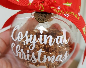 Made to order. Christmas Glass Baubles. Filled with snowy scenes or Christmas decorations. Purchase and 10% of the price will go to charity.