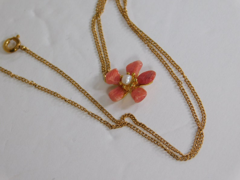 Gold fill chain signed arrow in circle with pink stone petal flower pendant has tiny faux pearl in center