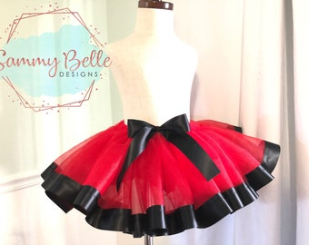 Red and Black ribbon trim girls tutu Red tulle with Black trim and bow!