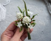 Wedding rustic greenery boutonniere with white clover, elegant grooms