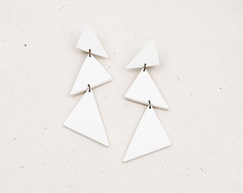 Fun, playful, geometric, colorful drop polymer clay earrings made with a series of triangles // Collection: Candy Raindrops (single color)