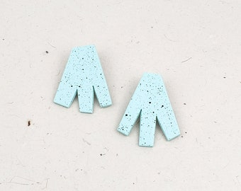 Fun, funky, modern, artsy, and specked asymmetrical statement stud earring // Collection: Paper Cutout