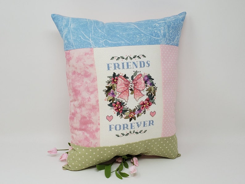 Finished Cross-Stitched FRIENDS FOREVER ANGEL Pillow on 14 count white aida with Silver Heart Charm