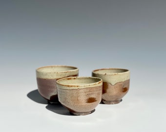 Hand made wood fired ceramic grippy cup