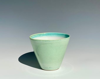 Handmade porcelain cup in minty crystally green