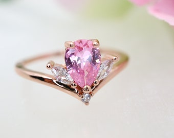 Custom design ring in payment plan for bertag93 14k white gold pear shaped white sapphire engagement ring in size 6.75