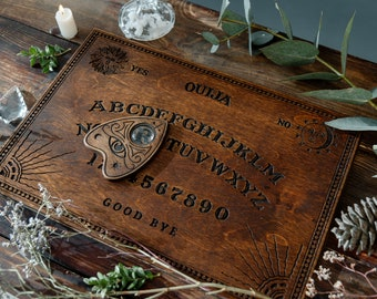 Old walnut Ouija board, Spirit game for talking to the souls of the dead, Witch craft, Brown wooden board, Occult practice, Halloween Party