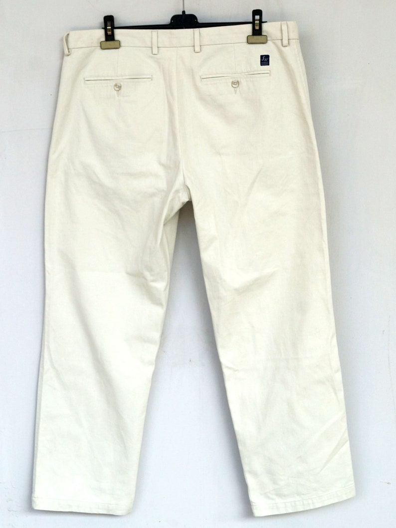 Vintage style 80s  high-rise cotton  white chinos by Samuel Windsor.