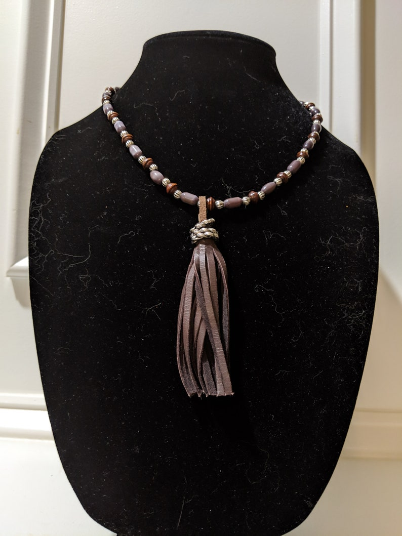 36 Lavender and brown beads with brown leather tassel