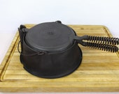 Lodge 8, High Base, Cast Iron Waffle Iron with pin hinge and offset, Alaskan Coil Handles. Very Good Used Condition