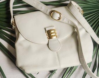 ee235fc236e white vegan leather crossbody bag