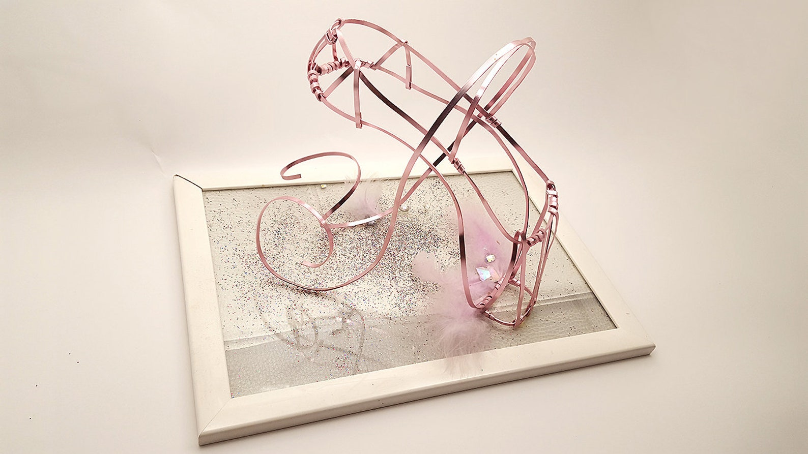 pink ballet shoe in aluminum wire