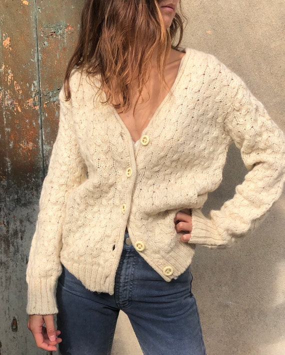 Soft white cable-knit wool cardigan made in Italy