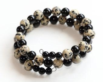 A handmade memory wire bracelet using dalmatian jasper & black onyx beads