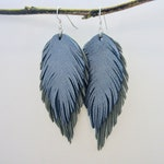 Shiny Powder Blue Double Feather Leather Earrings