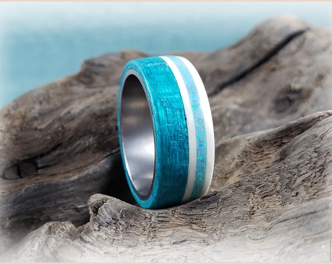 Bentwood Ring - Ocean Blue Koto and Ice White Maple w/Aqua Fire Opal inlay, on titanium core