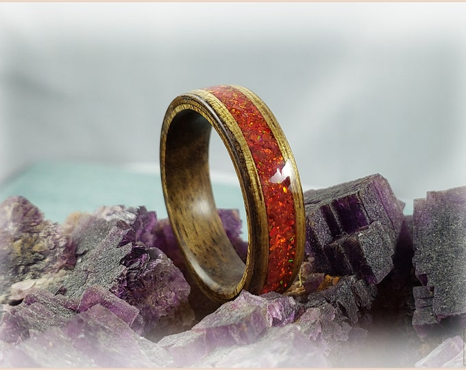 Bentwood Ring - Black Limba w/Ruby Fire Opal inlay, on Hawaiian Koa ring core