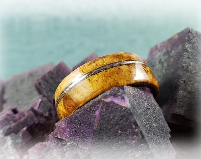 Bentwood Ring - Rare Amboyna Burl w/offset guitar string inlay on polished black ceramic core ring core