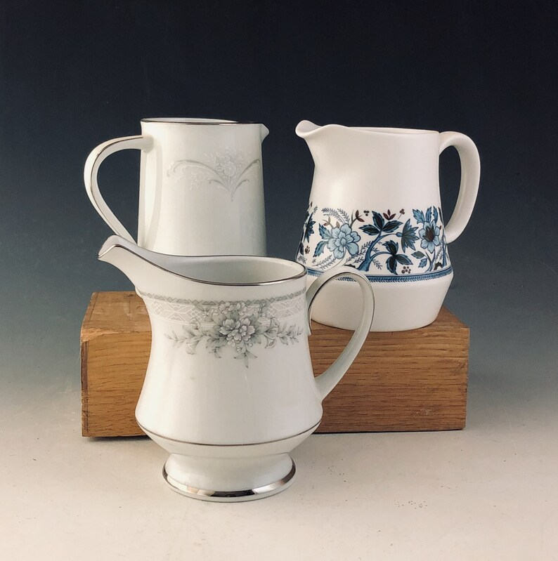 Collection of three lovely little china pitchers
