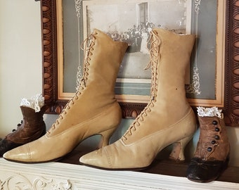 A lovely pair of 1900's lace-up boots in skin and leather. antique shoe, antique boots, victorian boots, edwardian boots, victorian shoe